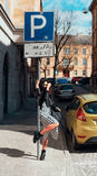 Beautiful fashionable lady posing on old street Royalty Free Stock Photos