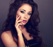 Beautiful fashionable makeup woman with long curly volume hair a Stock Photography