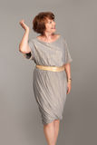 Beautiful fashionable mature woman in grey dress Royalty Free Stock Photography