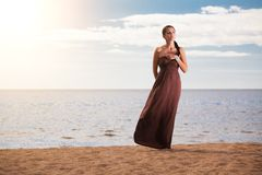 Beautiful fashionable model on the beach Stock Photos