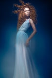 Beautiful fashionable red-haired girl in  transparent dress,  mermaid image with creative hairstyle curls. Fashion beauty style. Stock Images