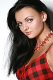 Beautiful fashionable woman. Close-up portrait of a beautiful girl in a black-red dress stock image
