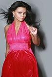 Beautiful fashionable woman in red dress. On gray background stock photos