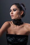 Beautiful fashionable woman in black background Royalty Free Stock Photos