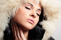 Beautiful fashionable woman with fur. white fur hood. winter Stock Photos