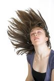 Beautiful fashionable woman with moving hair Stock Image