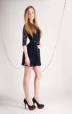 Beautiful fashionable woman near chain swing Royalty Free Stock Photography