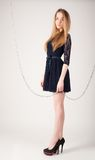 Beautiful fashionable woman near chain swing Stock Image