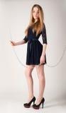 Beautiful fashionable woman near chain swing Royalty Free Stock Images