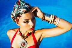 Beautiful fashionable woman near the pool Royalty Free Stock Photos
