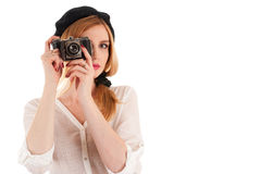 Beautiful fashionable woman photographing retro camera Stock Image