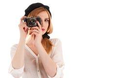 Beautiful fashionable woman photographing retro camera Stock Image