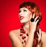 Beautiful fashionable woman with red nails and red hairs royalty free stock photo