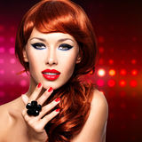 Beautiful fashionable woman with red nails and red hairs Royalty Free Stock Photography