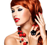 Beautiful fashionable woman with red nails and red hairs Stock Photo