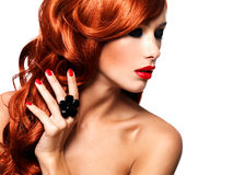 Beautiful fashionable woman with red nails and red hairs Royalty Free Stock Image