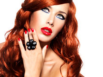 Beautiful fashionable woman with red nails and red hairs royalty free stock photos