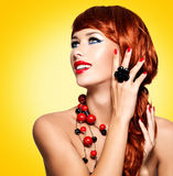 Beautiful fashionable woman with red nails and red hairs Stock Images