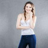 Beautiful fashionable woman smiling. On a gray background Stock Image