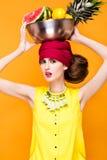 Beautiful fashionable woman an unusual hairstyle Stock Photos