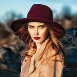 Beautiful fashionable woman wearing red hat Stock Images