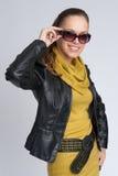 Beautiful fashionable woman wearing sunglasses Stock Photo