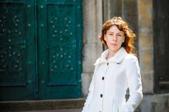 Beautiful fashionable woman in white coat posing Royalty Free Stock Images