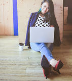 Beautiful fashionable woman working with laptop Royalty Free Stock Photography