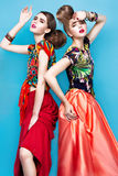 Beautiful fashionable women an unusual hairstyle Royalty Free Stock Images