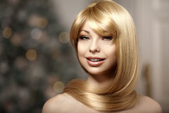 Beautiful fashionable young woman with luxurious hair. Beautiful Stock Photos