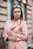 Beautiful fashionable young woman wearing pink stylish autumn jacket stock image