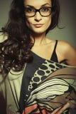 Beautiful fasion girl in glass. Beautiful fasion girl in black glass Stock Image