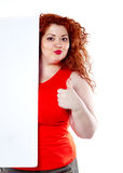 The beautiful fat, big sensuality woman with red lipstick and with red t-shirts holding the white bilboard Royalty Free Stock Photos