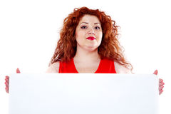 The beautiful fat, big sensuality woman with red lipstick and with red t-shirts holding the white bilboard. On the white background. When she hold bilboard the Royalty Free Stock Photography