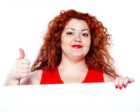 The beautiful fat, big sensuality woman with red lipstick and with red t-shirts holding the white bilboard Stock Images