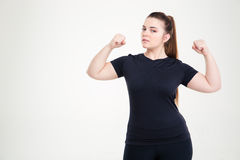 Beautiful fat woman showing her biceps Royalty Free Stock Image