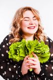 Beautiful fat young woman with bright emotions on a light gray background. Concept of diet. Space for text. Design royalty free stock photo