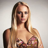 Beautiful fatal blond woman in dress. Studio shot of beautiful fatal blond woman in dress stock photo