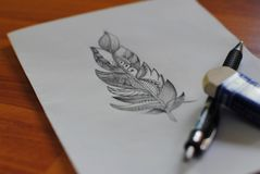 Beautiful feather drawn in pencil royalty free stock image