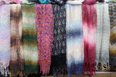 Beautiful feather scarves of different colors. Royalty Free Stock Images