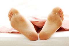 Beautiful feet in bed Royalty Free Stock Photo