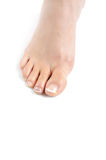 Beautiful feet leg with perfect french pedicure Stock Photography