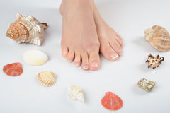 Beautiful feet with perfect french spa pedicure Royalty Free Stock Images