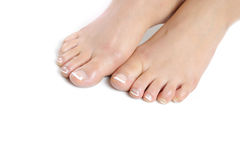 Beautiful feet with perfect french spa pedicure Stock Images