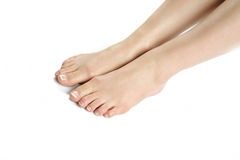 Beautiful feet with perfect french spa pedicure Royalty Free Stock Photography