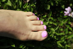 Beautiful feet relaxing at the outdoor spa Royalty Free Stock Photos