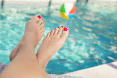 Beautiful Feet and toes by the swimming pool Royalty Free Stock Images