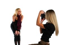 Beautiful felame photographer taking picture of a model Royalty Free Stock Photo