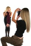 Beautiful felame photographer taking picture of a model Royalty Free Stock Photography
