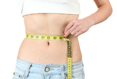 Beautiful female abdomen and measuring tape Royalty Free Stock Photography